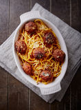 Linguine baked with meatballs, tomato sauce and parmesan Stock Photos