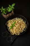 Linguine with Basil in Cast Iron Pan stock photos