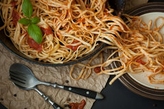 Linguine with Basil and Red Sauce in Cast Iron Pan Stock Images