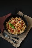 Linguine with Basil and Red Sauce in Cast Iron Pan royalty free stock images
