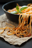 Linguine with Basil and Red Sauce in Cast Iron Pan Royalty Free Stock Photography