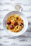 Linguine with meatballs, tomato sauce and parsley Stock Image