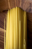 Linguine pasta. Raw linguine pasta put on wooden tray Royalty Free Stock Photos