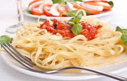 Linguine pasta with fresh tomato sauce and basil Royalty Free Stock Photo