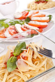 Linguine pasta with fresh tomato sauce and basil Stock Images