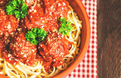 Linguine pasta with meatballs in tomato sauce and parsley Royalty Free Stock Images