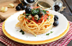 Linguine pasta olive and capers Stock Photos