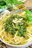 Linguine pasta by pesto Stock Image