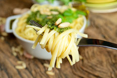 Linguine pasta by pesto Stock Images