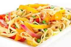 Linguine pasta with vegetables angle upclose. Shot of linguine pasta with vegetables angle upclose Royalty Free Stock Photo