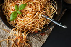 Linguine with Red Sauce and Fresh Basil in a Cast Iron Pan stock image