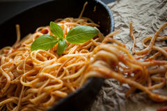 Linguine with Red Sauce and Fresh Basil in a Cast Iron Pan Royalty Free Stock Images