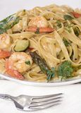 Linguine with shrimp. Asparagus and basil seasoning Stock Photos