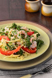 Linguine with shrimp, broccolini and red peppers Stock Images