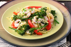 Linguine with shrimp, broccolini and red peppers Stock Photos