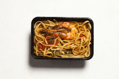 Linguini Shrimp delivery. Studio shot Stock Photos