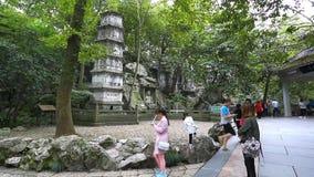 Lingyin Temple Garden in Hang Zhou. HANGZHOU, CHINA - NOV 22: Tourists starting to return to popular vacation spots like the Lingyin Temple Garden in Hang Zhou stock footage