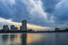 Linh Dam lake at sunset with cloudy sky. Hanoi cityscape.  Stock Photography