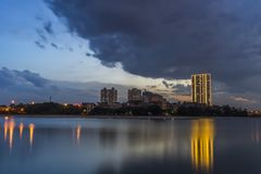 Linh Dam lake at sunset with cloudy sky. Hanoi cityscape.  Stock Photo