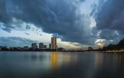 Linh Dam lake at sunset with Linh Dam lake at sunset with cloudy sky. Hanoi cityscape.cloudy sky. Hanoi cityscape. Linh Dam lake at sunset with cloudy sky. Hanoi Stock Photography