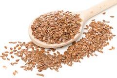 Linhaça ou semente de linho crua, não processada na colher de madeira Imagem de Stock Royalty Free