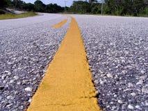 Linha amarela na estrada Imagem de Stock Royalty Free