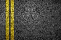 Linha amarela no asfalto Foto de Stock Royalty Free