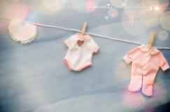 Linha da roupa da festa do bebê Fotos de Stock