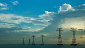 Linha de alta tensão no mar e no céu azul Foto de Stock Royalty Free