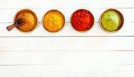 Linha de especiarias à terra coloridas Imagem de Stock Royalty Free