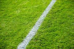 Linha de giz no campo do futebol ou de futebol Fotografia de Stock Royalty Free