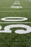 Linha de jardas 50 no campo de futebol Fotografia de Stock Royalty Free