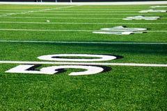 Linha de jardas 50 no campo de futebol Imagens de Stock Royalty Free