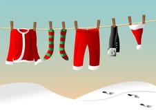 Linha de roupa para o terno de Santa Fotografia de Stock Royalty Free