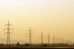 Linha de transmissão no por do sol Foto de Stock