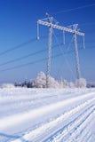 Linha eléctrica no gelo. Inverno Fotos de Stock Royalty Free