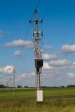 Linha elétrica em campos verdes Fotografia de Stock