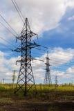 Linha elétrica na floresta Imagens de Stock Royalty Free
