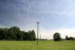 Linha elétrica no campo Imagem de Stock Royalty Free