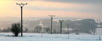Linha elétrica no inverno Fotografia de Stock Royalty Free