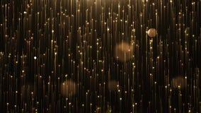 Linha glamoroso e partículas do brilho do ouro em um fundo preto filme