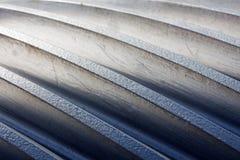 Linha no metal de um fim da roda denteada acima Foto de Stock