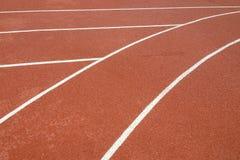 A linha running pistas da borracha da trilha Foto de Stock