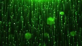 Linha verde glamoroso e partículas do brilho em um fundo preto filme