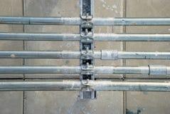 Linhas da tubulação com telhas Fotografia de Stock Royalty Free