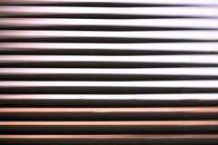Linhas de fluxo abstratas do fundo de uma cortina Fotografia de Stock Royalty Free