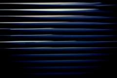 Linhas de fluxo abstratas do fundo de uma cortina Foto de Stock