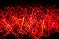 Linhas de fogo abstratas que formam várias formas Fotos de Stock