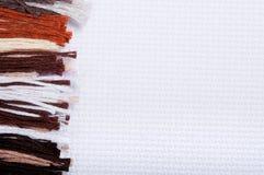 Linhas do bordado e fundos de matéria têxtil Fotografia de Stock Royalty Free