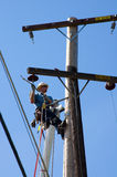 Linhas eléctricas da fixação foto de stock